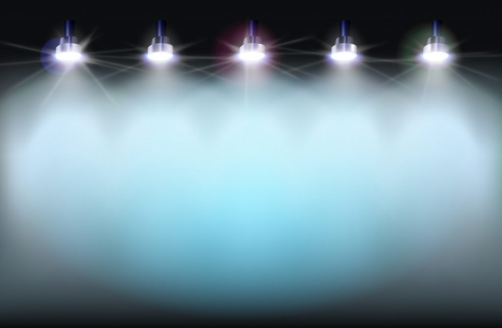Light display overhead aiming down onto a large format banner