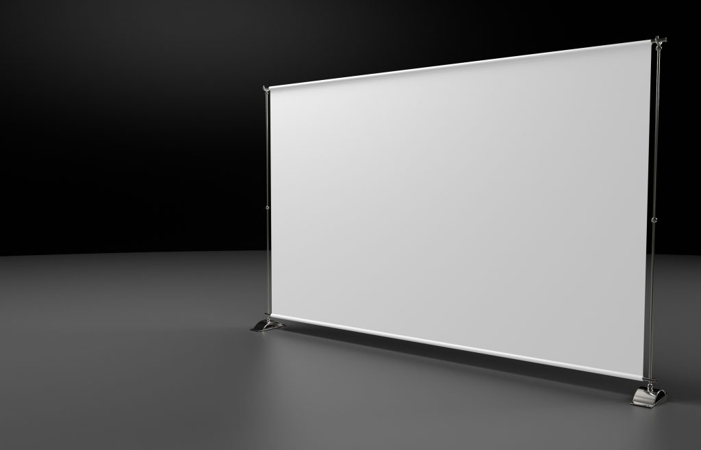 Blank backdrop banner on a metal pole frame