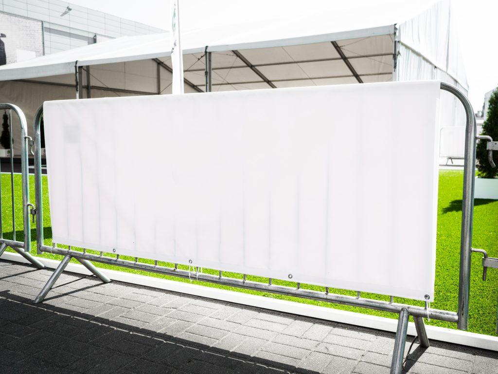 Open Vinyl Banner on an outdoor barricade