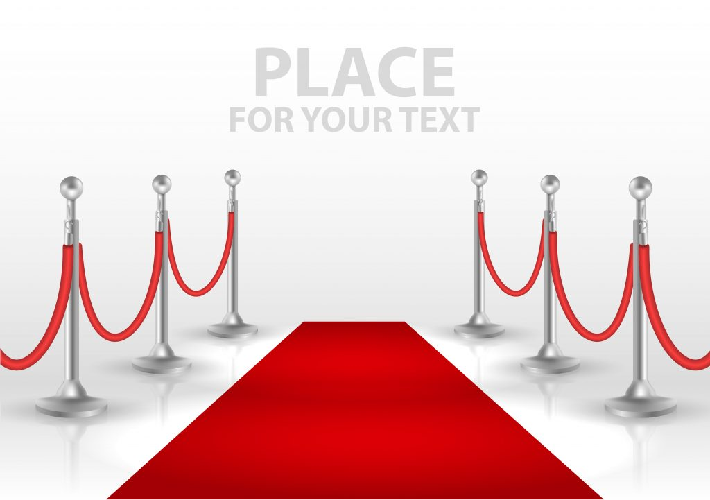 Red Carpet and velvet rope leading to a step and repeat banner